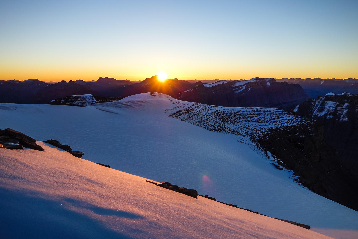 Looking back over our bivy site as the sun rises over Mount Cline.