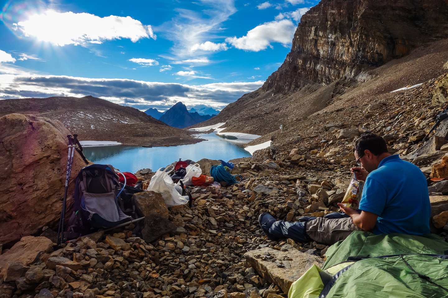 Eric eats supper at our delightful bivy. Iceberg Lake is about 40 feet below us here.