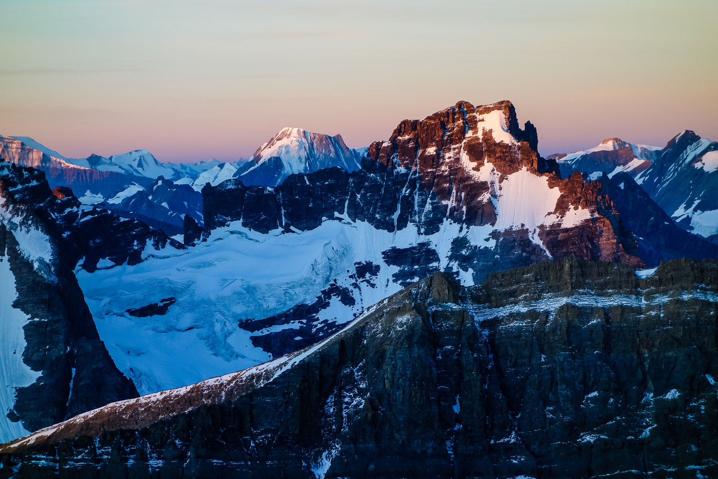 The mighty Mount Clemenceau rises in the morning sun with Mount Shackleton to the left.