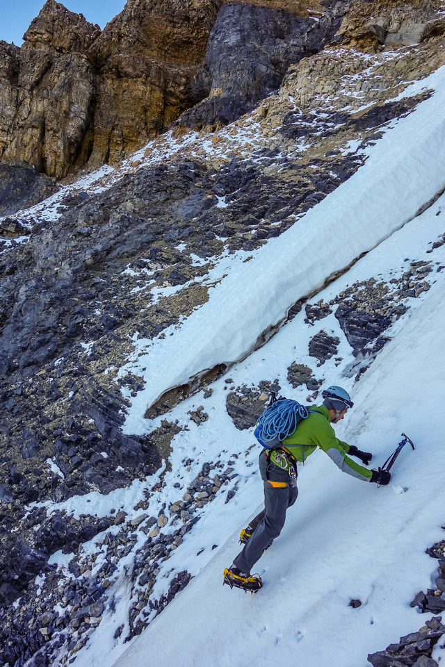 Kev front points across an icy gully.