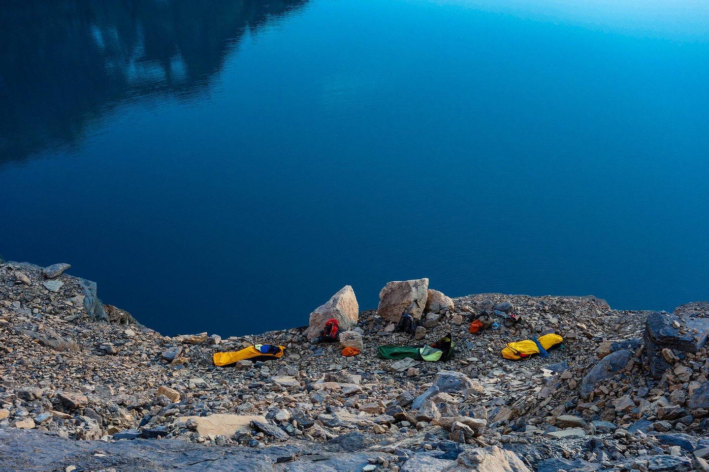 Looking at our bivy from above. I put rocks around mine (left) because of the 40 foot drop to the lake right by it!