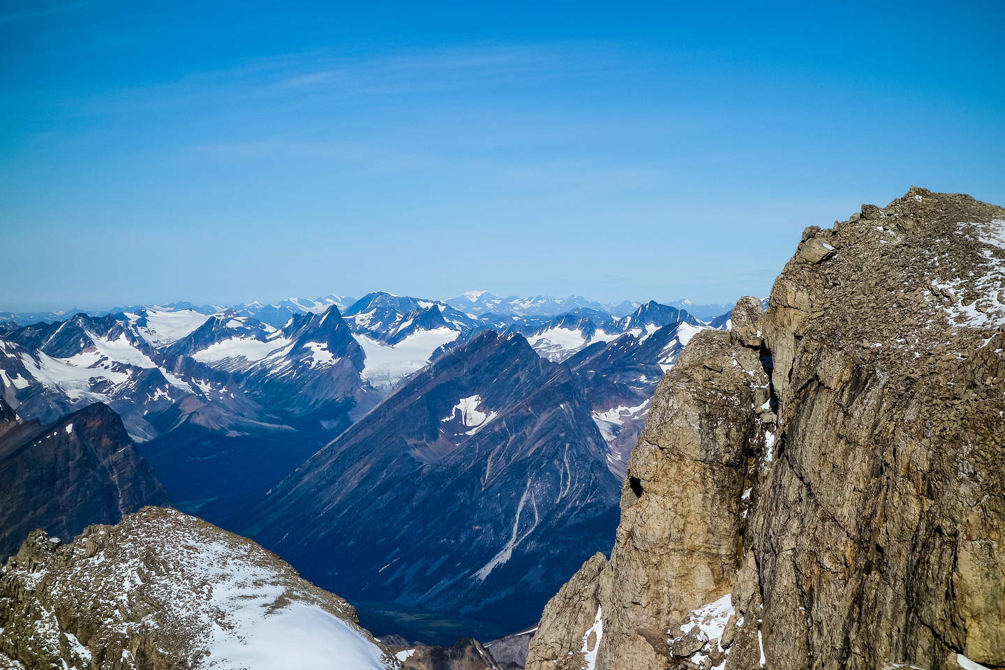 Looking over the difficult looking north ridge. The 5.7 chockstone route visible in a steep crack.