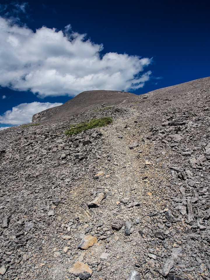 Ascending easy scree on Windtower.
