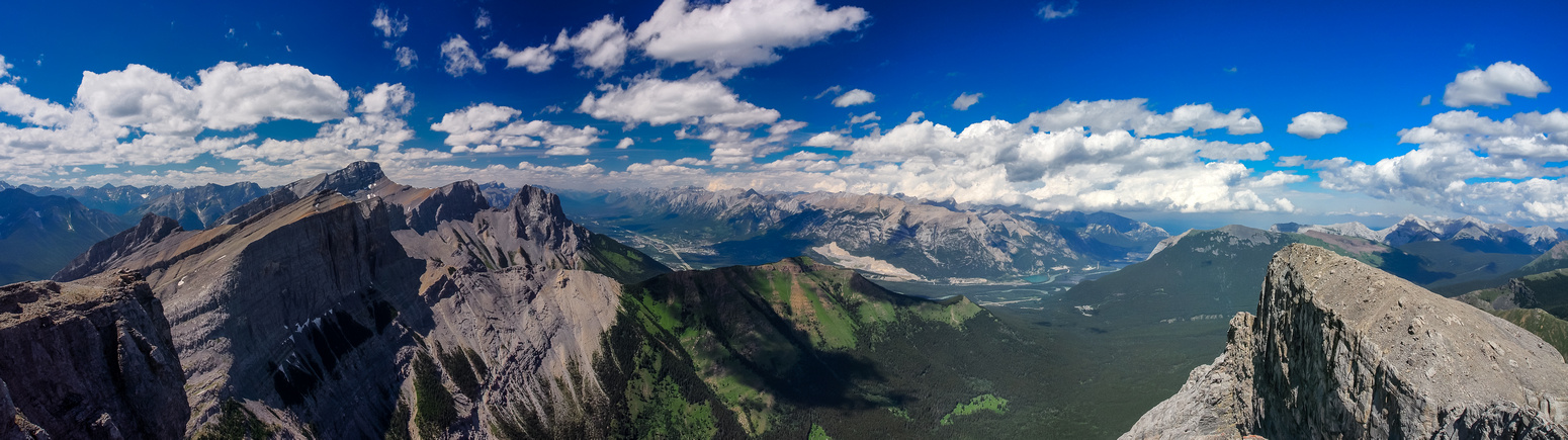 Summit view into the Bow Valley includes peaks such as Rimwall, Big Sister, Middle Sister and Little Sister at left.