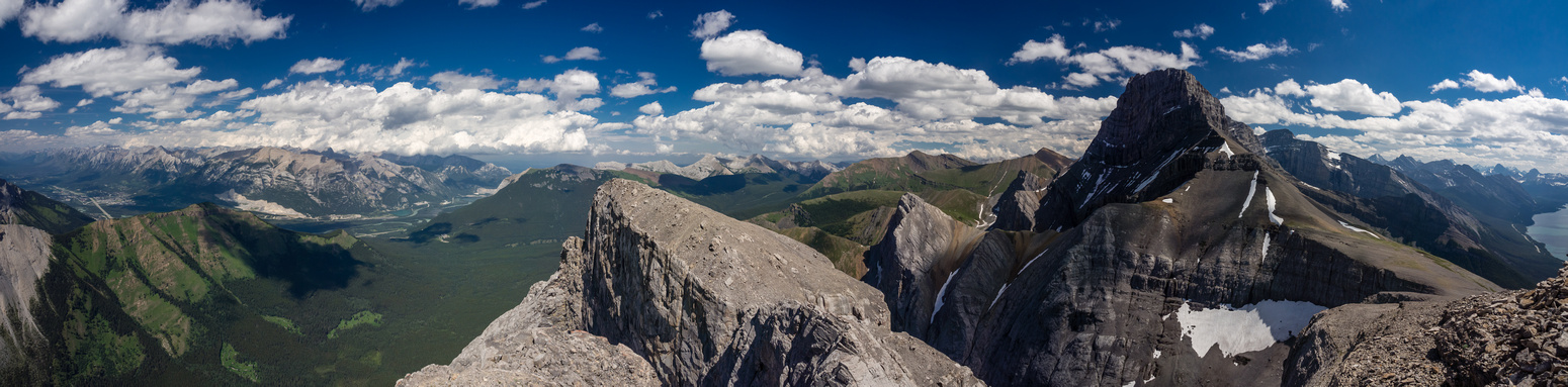 Summit views east to Lougheed I, Collembolla, Pigeon and the town of Exshaw. (R to L)