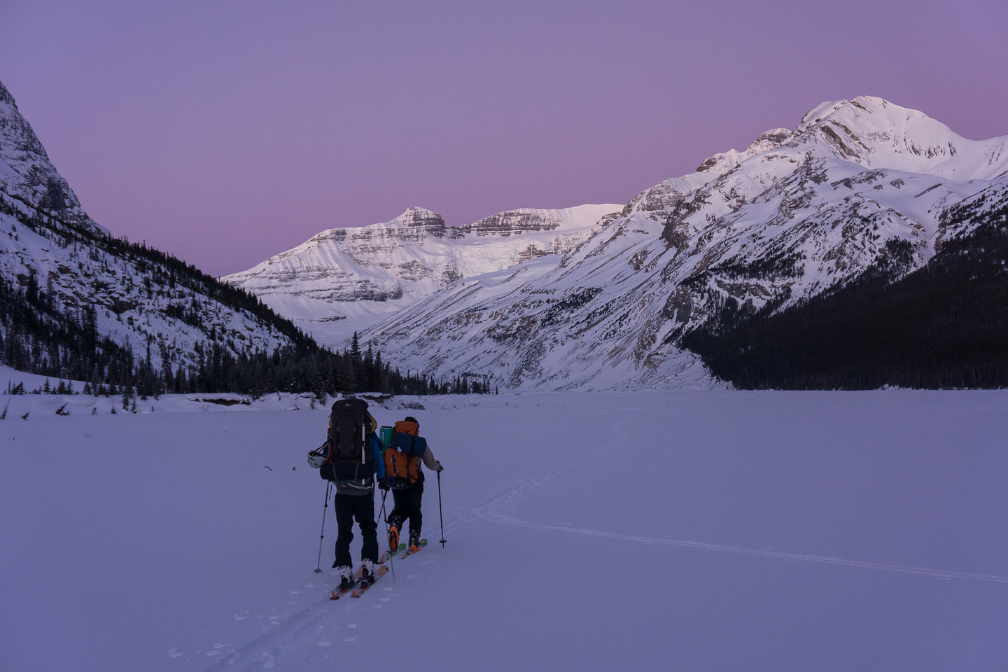 Crossing the lake, it's still early morning. On the right in the foreground is an outlier of Mount Athabasca. In the right background is Mount Andromeda.