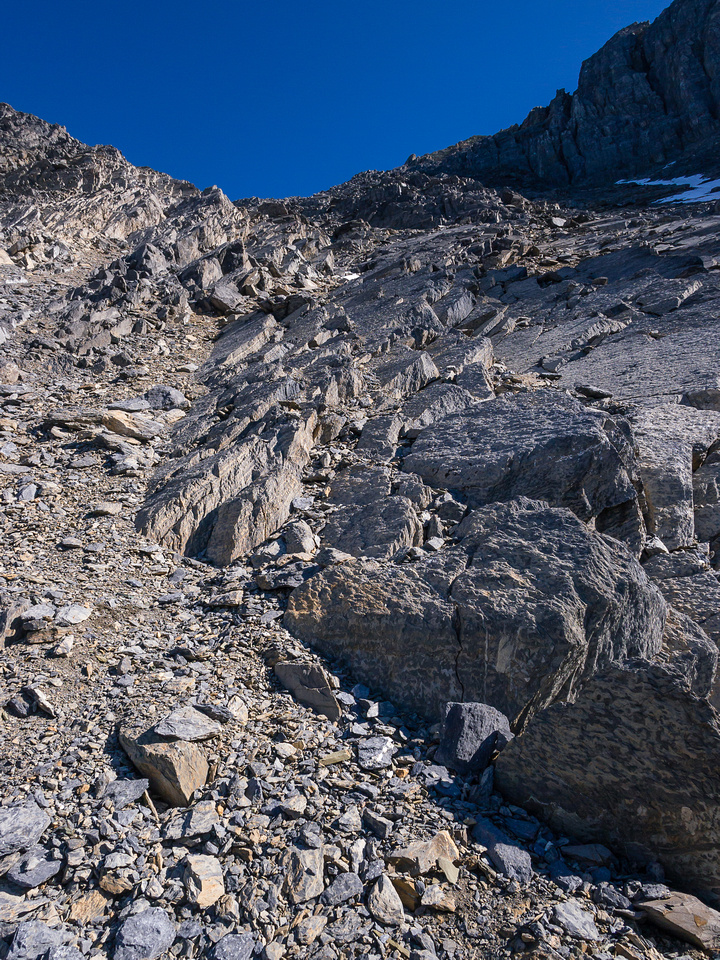 The terrain is horribly loose, the higher you go. It was likely covered by ice a short while ago and gets rearranged by avalanches each winter.