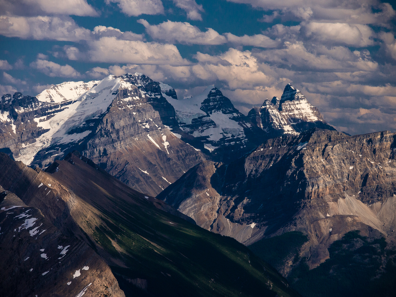 Lush green valleys with soaring ice fields and glacier capped peaks including Victoria and Hungabee.