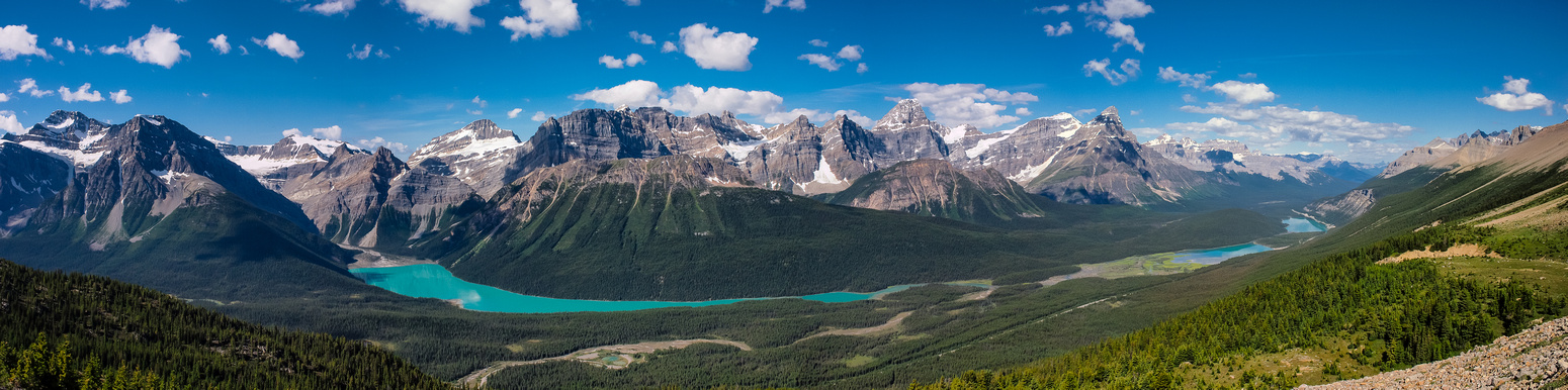 A panorama looking back over hwy 93. Mistaya Lake at left, Waterfowl Lakes at right.
