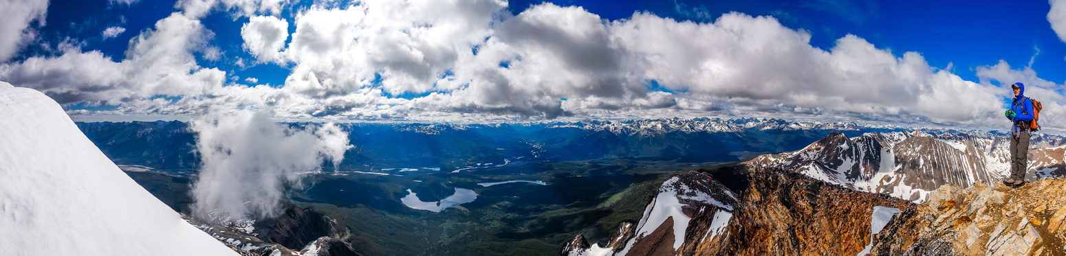 Great summit views with clouds swirling and deep greens in the valleys.
