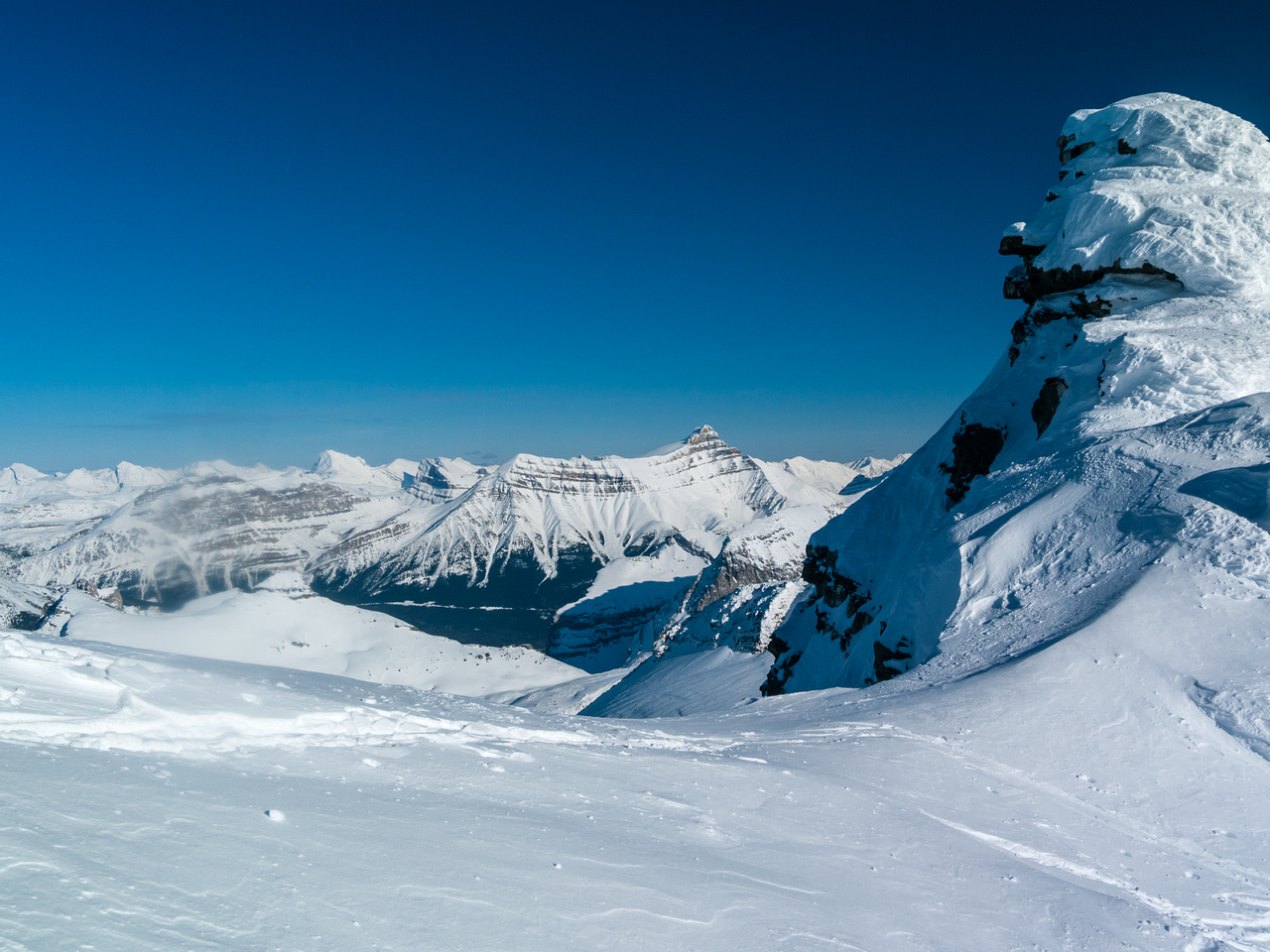 Just before dropping down on skis, looking over the high col.