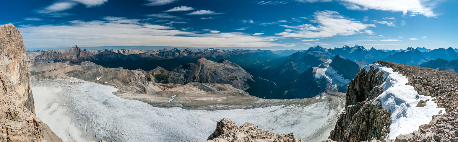 A summit ridge panorama looking south towards the Skoki area on the left and Lake Louise peaks on the right.