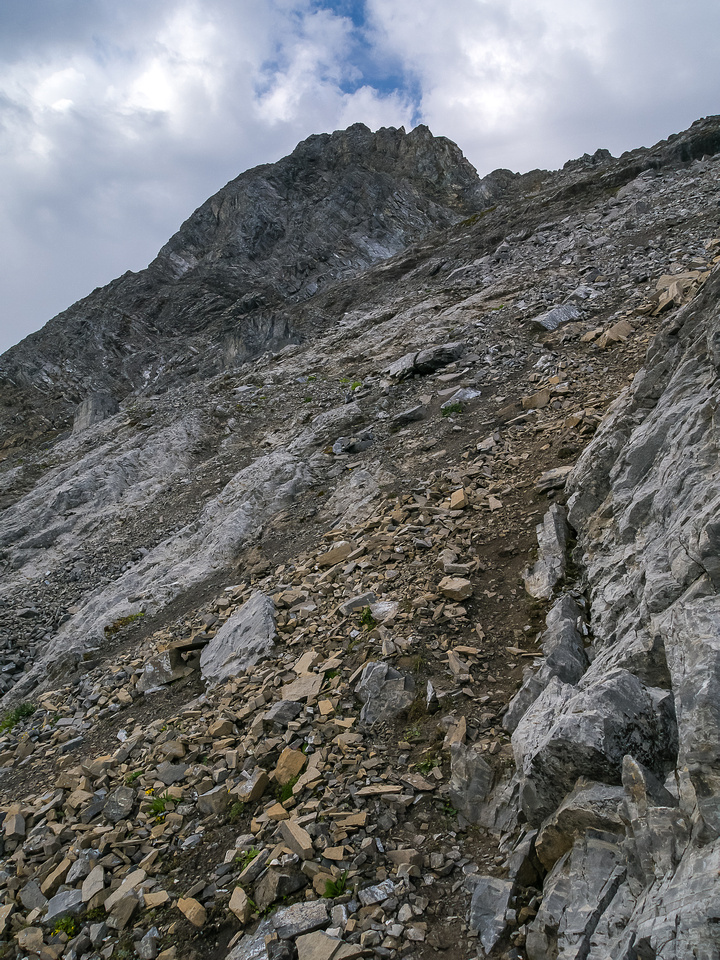 Steep and loose terrain above the col.