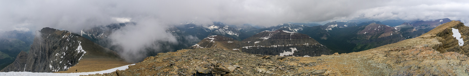 Summit panorama with the outlier at left, Blackiston in clouds at left, Lost at left of center with Festubert in clouds beyond, Kootenai-Brown and Bauerman at right of center with Kishinena Peak beyon