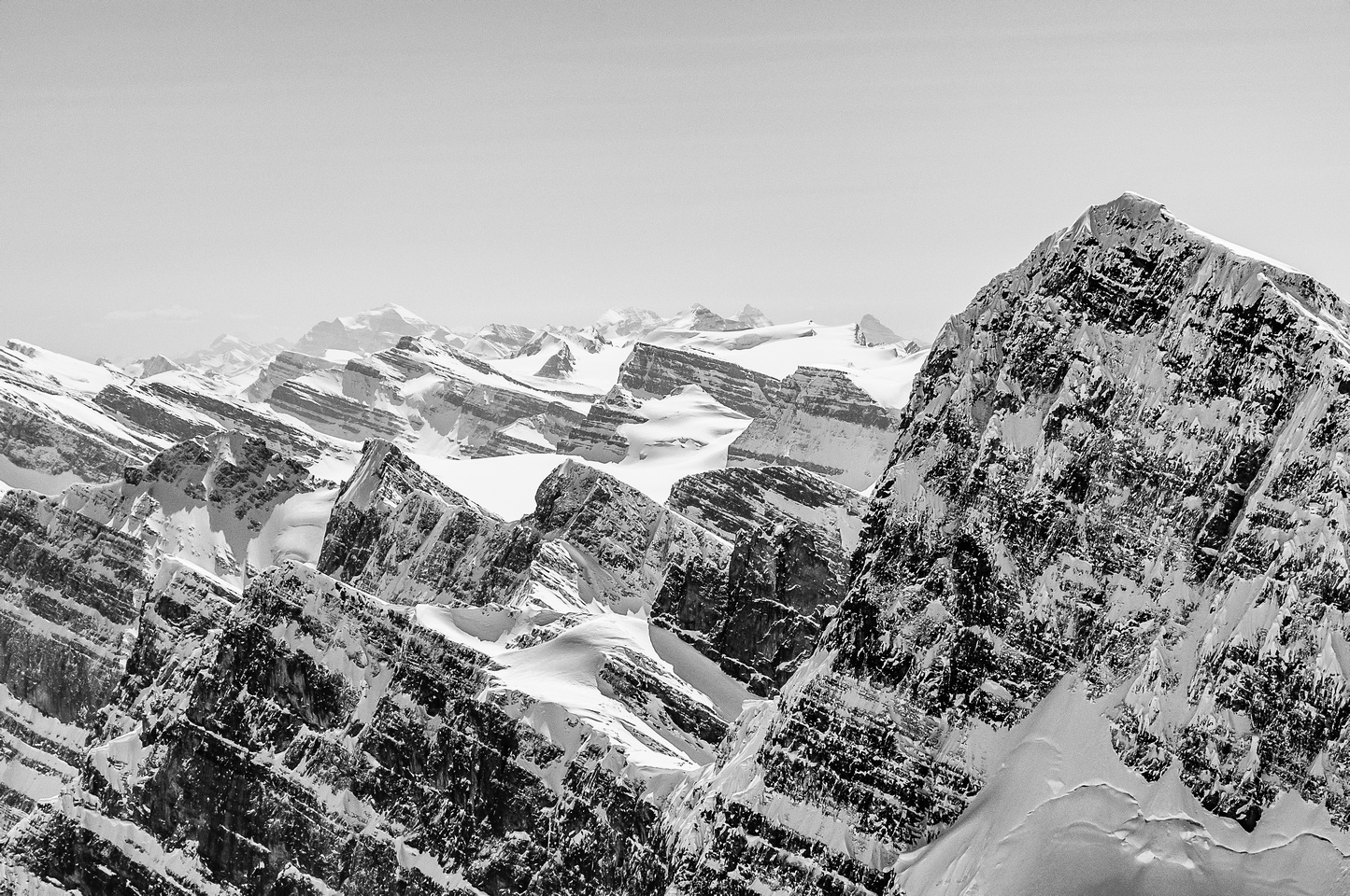 Mount Temple in the far distance with some Wapta peaks recognizable in front, including Thompson, Peyto, Olive, Rhondda and Habel.
