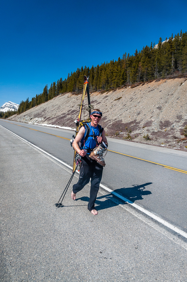 Tramping down the Icefields Parkway in bare feet with skis on our backs.