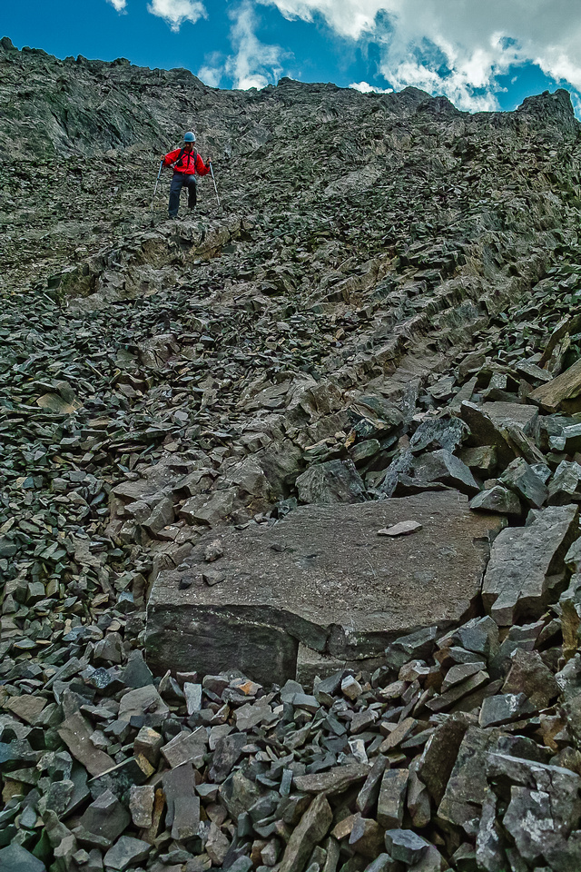 """Keith follows me as we start our """"lost traverse"""" across and down the west face and gully system on Mist."""