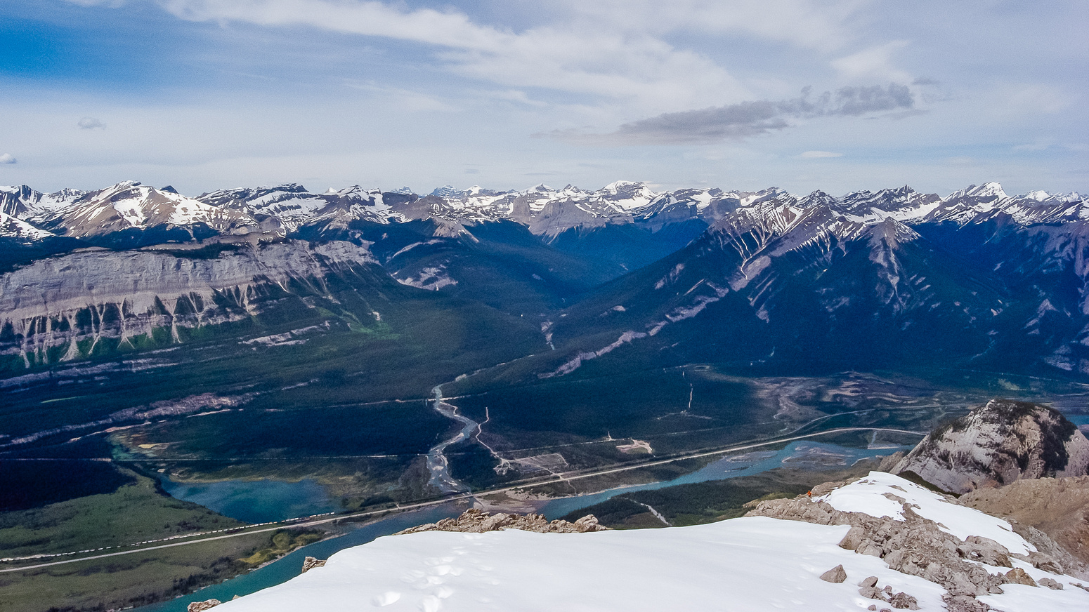 Looking down the summit ridge - note Wietse below me here - the Snaring River at center joining the mighty Athabasca River.