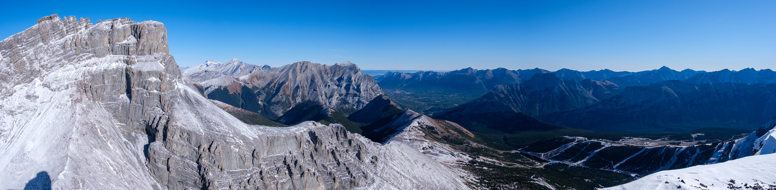 L to R, The Fortress, Sparrowhawk, Bogart , South Kidd, Kidd, Baldy, Wasootch, Kananaskis, Old Baldy, Limestone, The Wedge, Opal, Fisher, Denny, Evan-Thomas. The Fortress ski resort and runs visible a