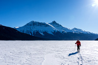 The endless crossing of Hector Lake. Mike with Hector Mountain rising in the distance.