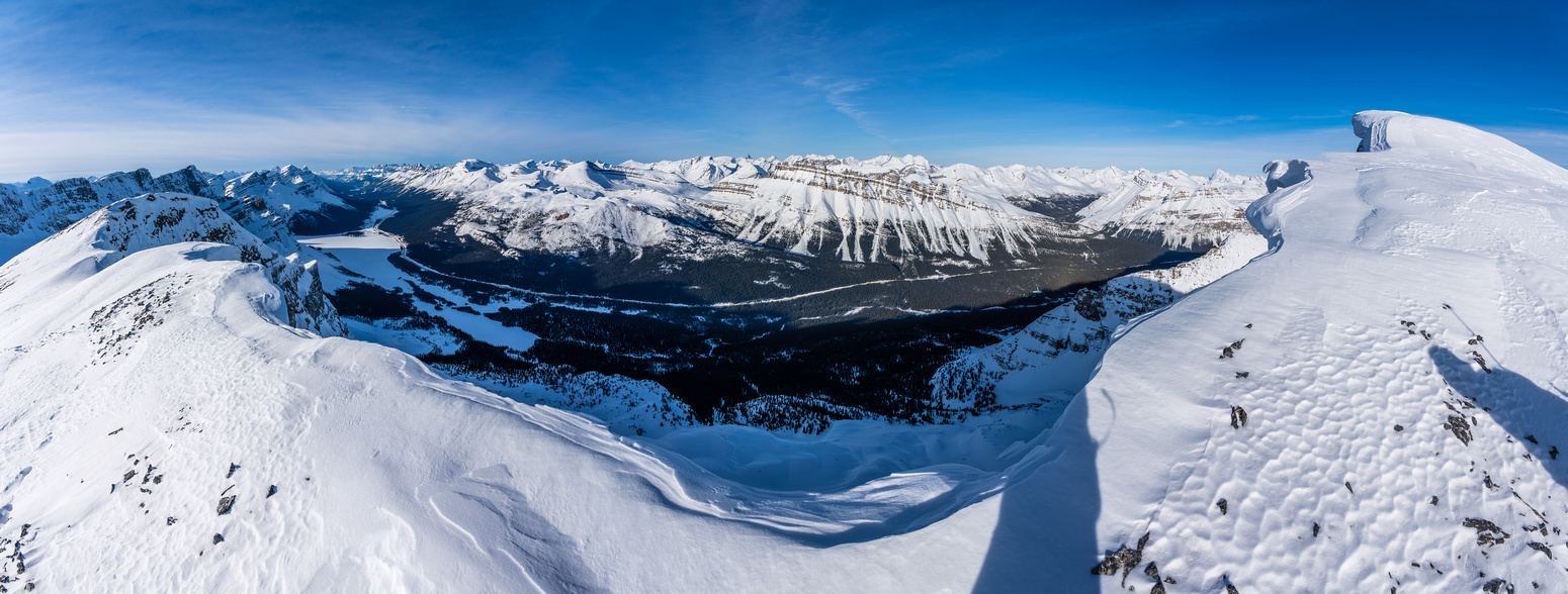 Incredible views over the Icefields Parkway towards Cirque and Bow Lake (L).