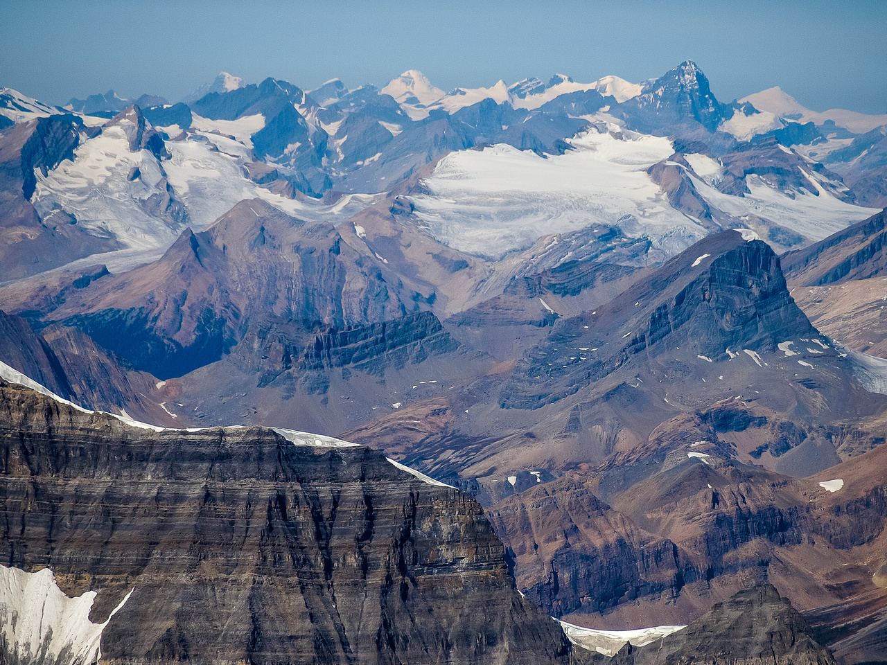 Mount Niles in the foreground with Yoho, Collie, Des Poilus, Bryce, Columbia, The Lyells, Forbes and many more peaks visible.