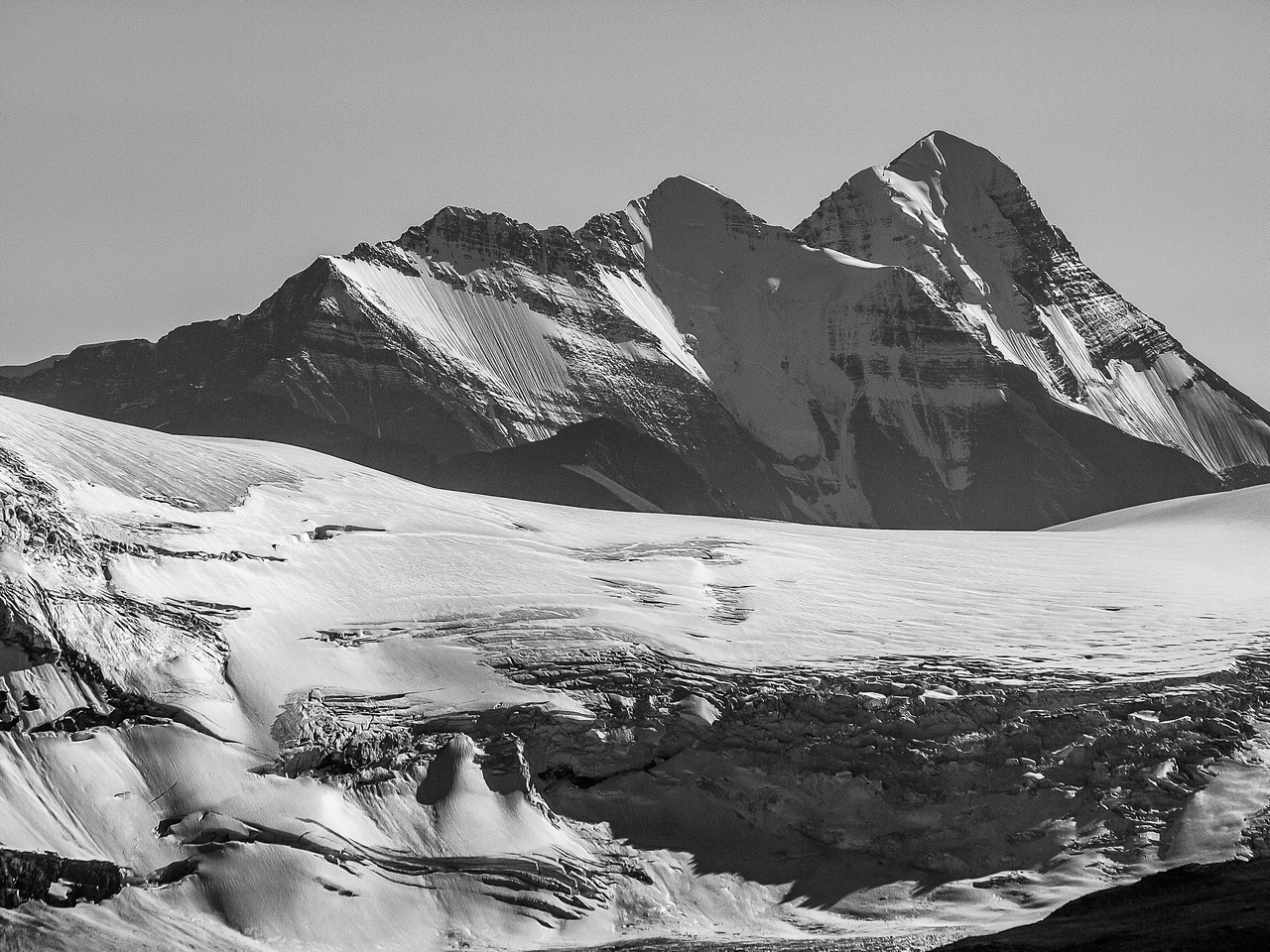 The mighty Mount Bryce looms over the Athabasca Glacier headwall in the foreground.