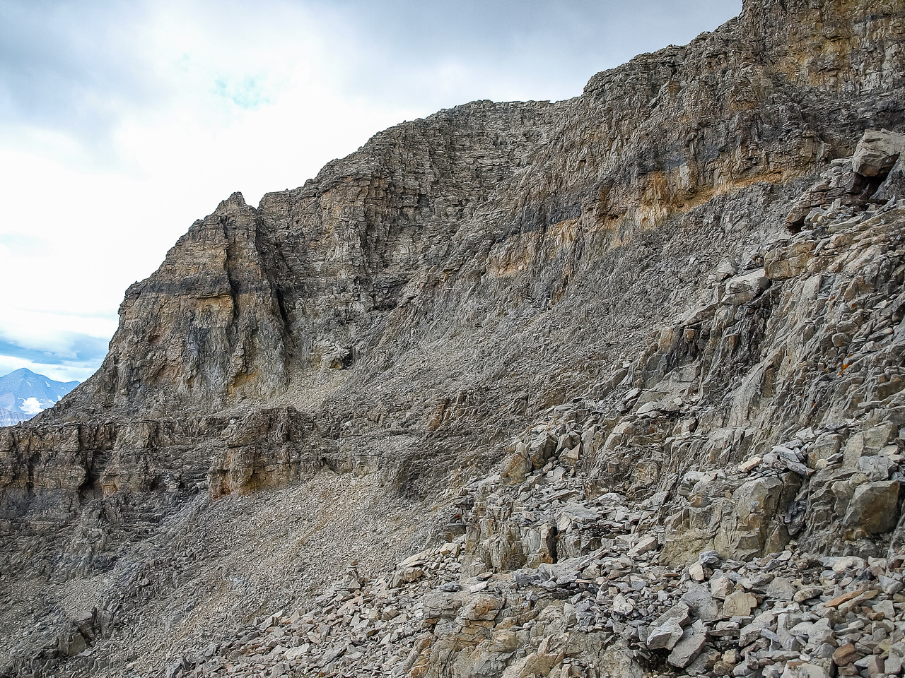The traverse from the col to the bottom of the crux gully to the summit which is left of center here.