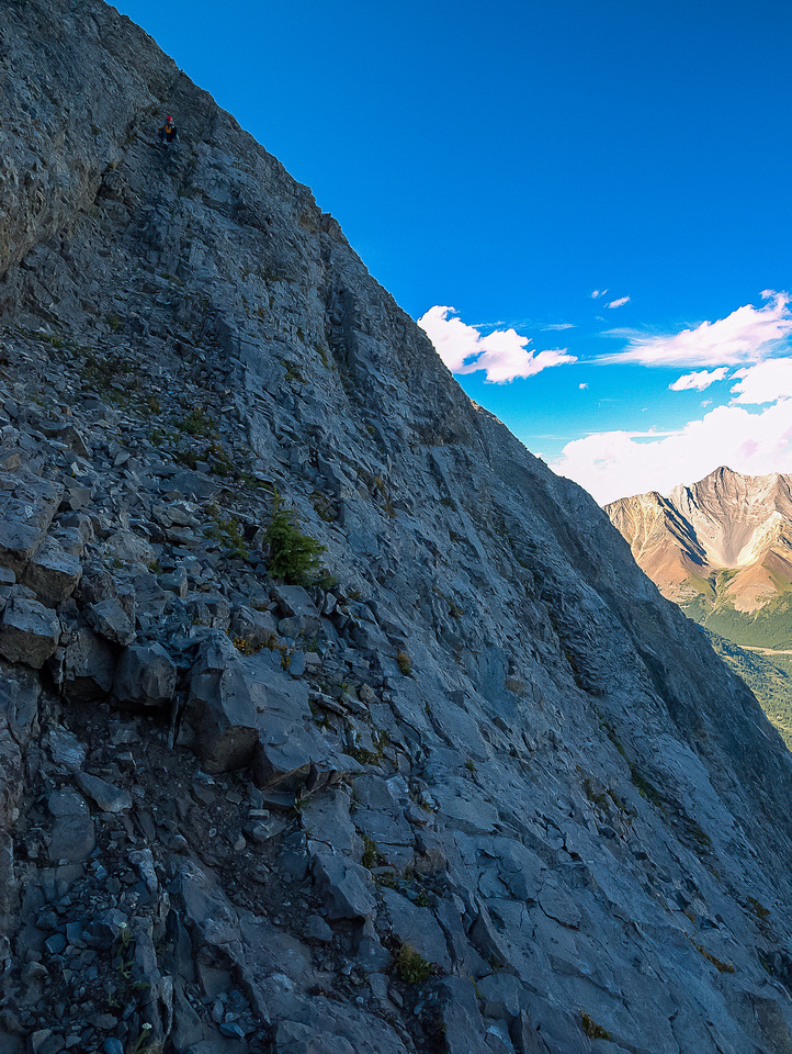 Retreating down a narrow ledge system on the east face.