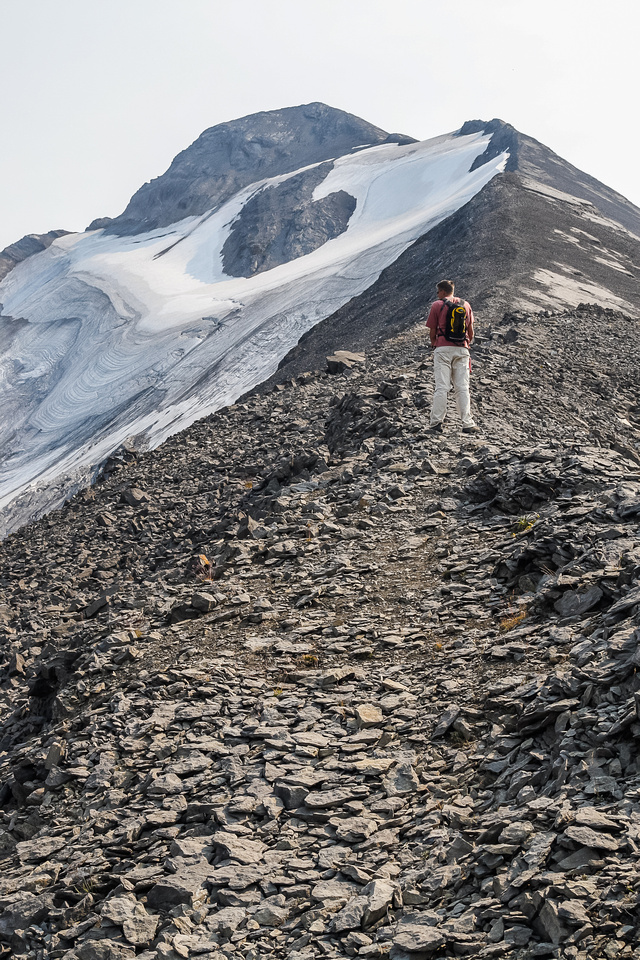 There is a good trail beaten into the scree. The only scrambling section other than the approach headwall is just above Jon here.