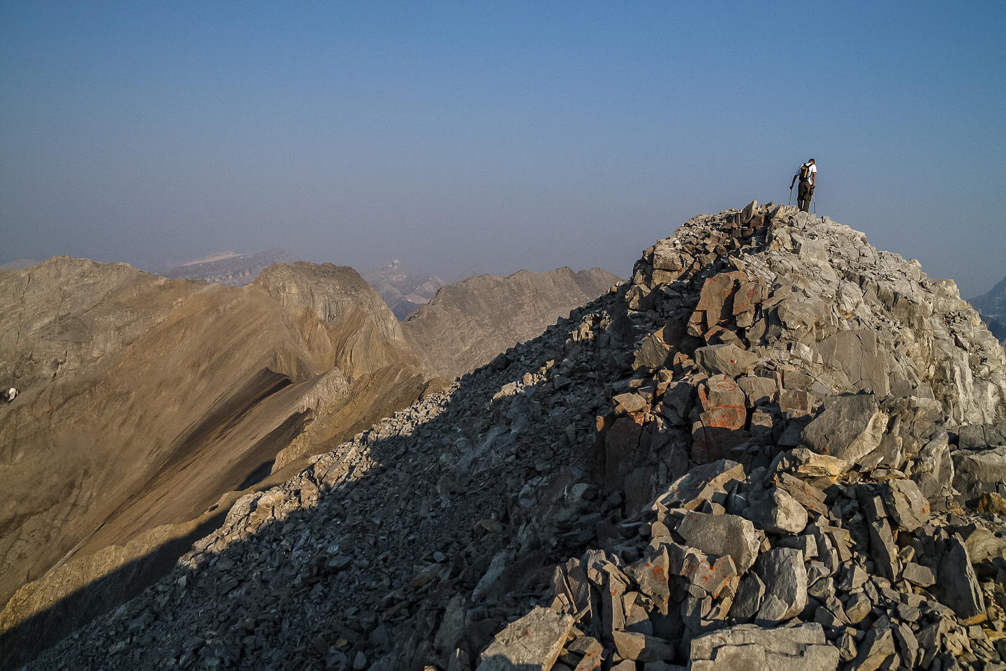 Jon ascends the summit ridge.