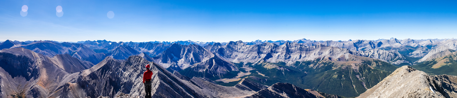 Summit views of many familiar Kananaskis peaks including (L to R), Storm, Rae, Tombstone, Opal Range, Evan Thomas, King George, Sir Douglas, Opal, Inflexible, James Walker, Eon, Aye, Assiniboine, Gala