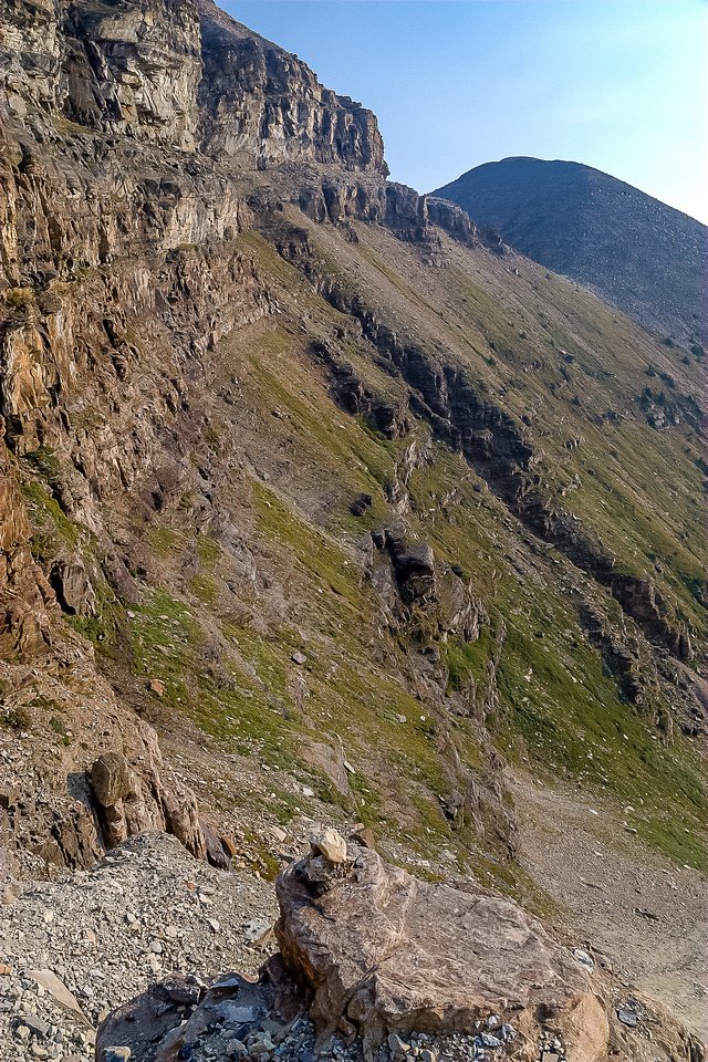 The curving cliffs to the St. Piran col as seen from ascending the waterfall / headwall.