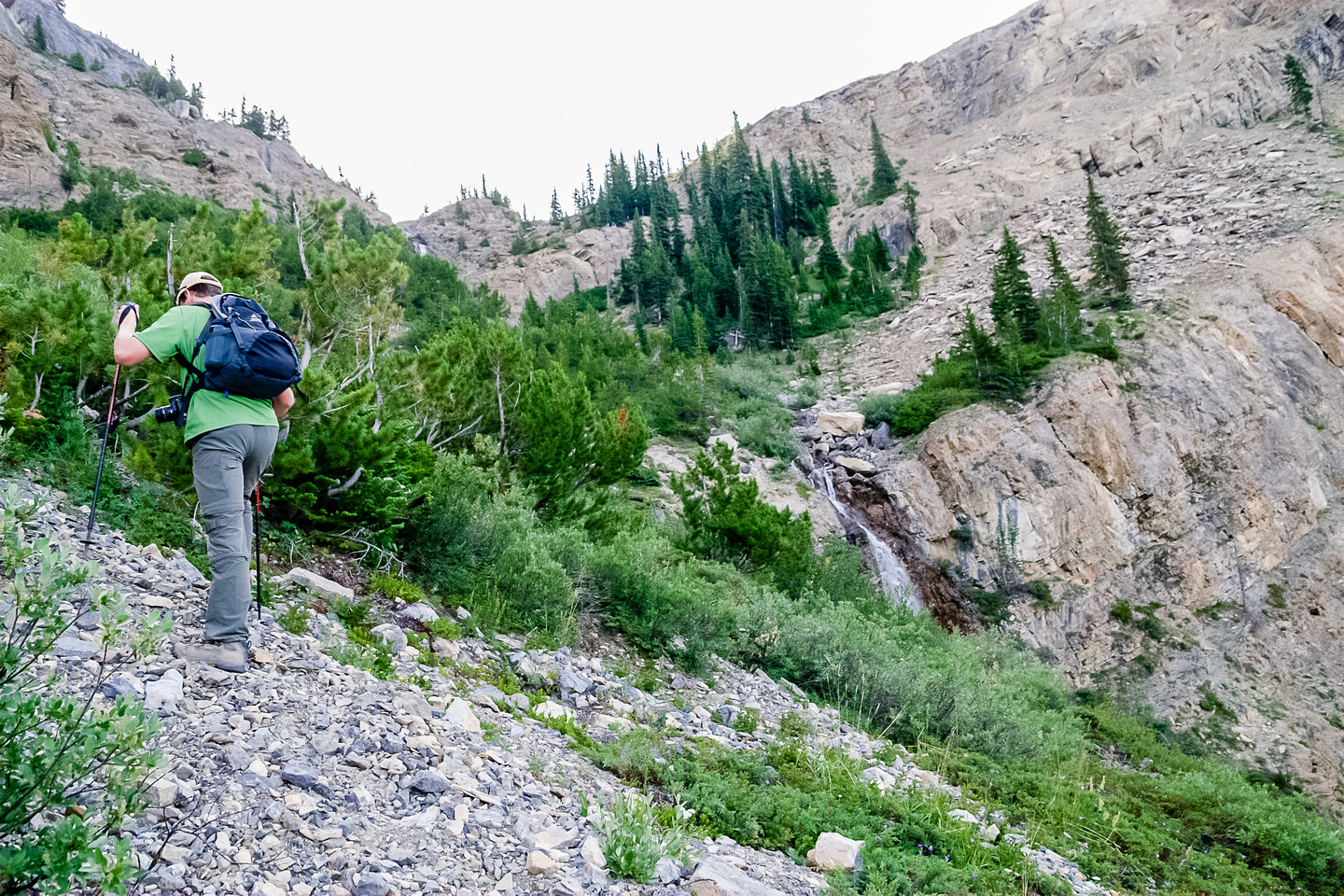 After following the trail through the trees lower down, we are now crossing the waterfalls on climber's left.