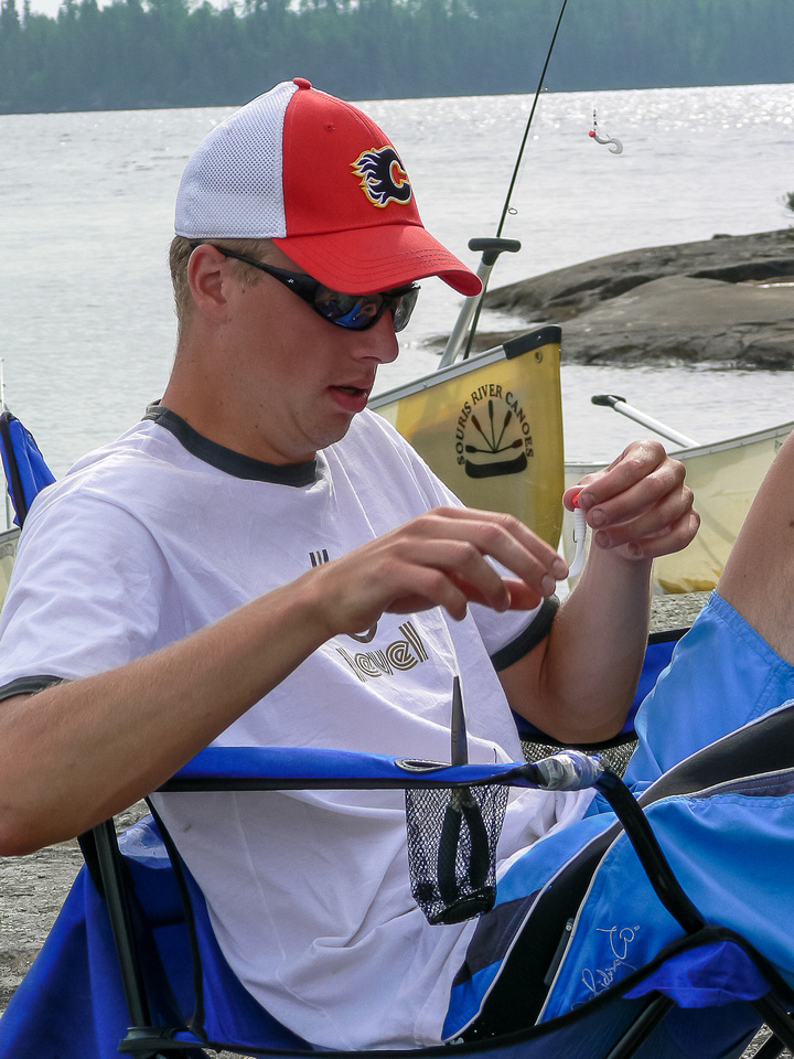 Eric fixes fishing gear at camp on Thursday morning on Chase Lake.