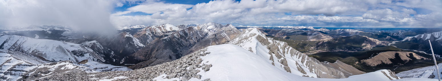 """""""Sheep Ridge"""" at distant right and Melanin Peak in the clouds at distant left with Barrier at center"""