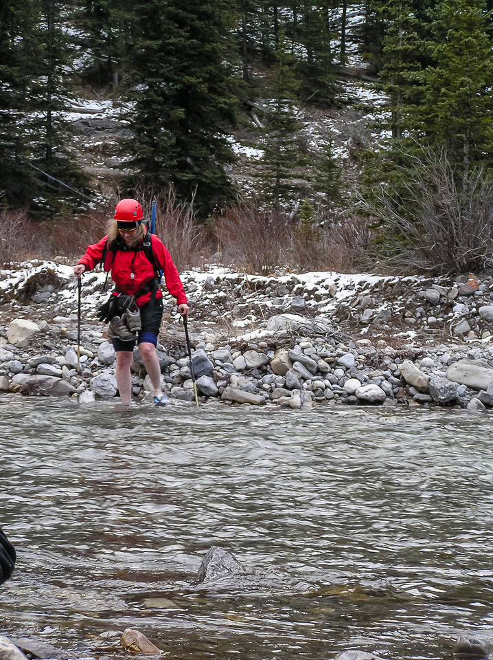 Linda crosses the Little Elbow River.