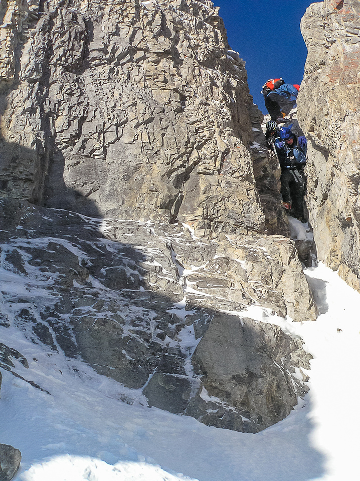 The 'Hillary Step' is all backed up! Dave S, Dave M and Frank are all heading down the difficult chimney on Mount Remus.