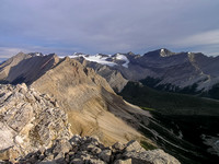 Mount Drummond on the right with Pipestone and Cyclone on the left. Peaks on the Drummond Icefield in the distance are mostly unnamed.