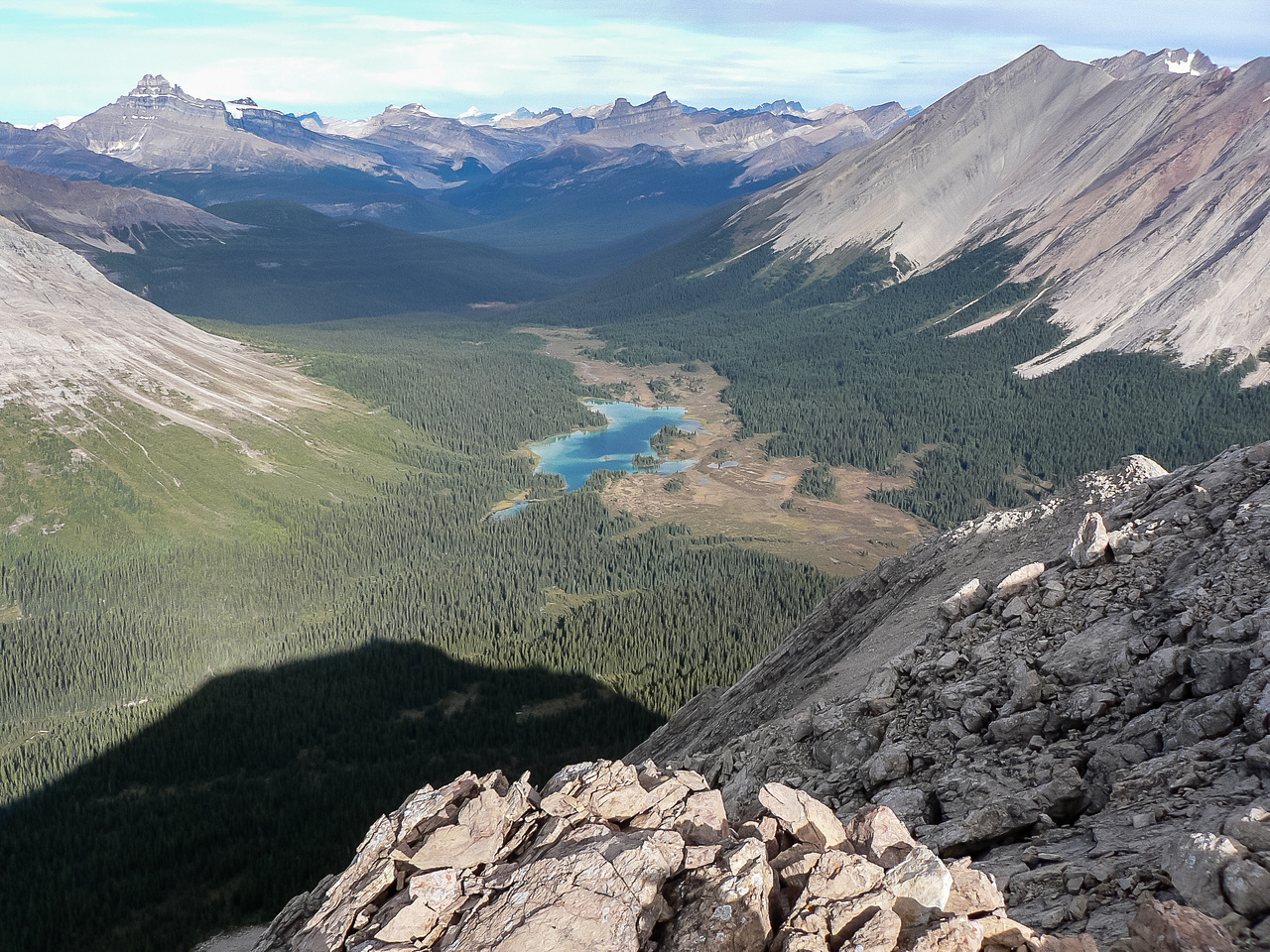 Looking over the Red Deer Lakes up the Little Pipestone River towards Hector and Molar Mountain.