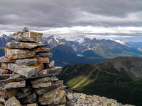 Summit cairn with Lake Louise and Mount Victoria in the bg.