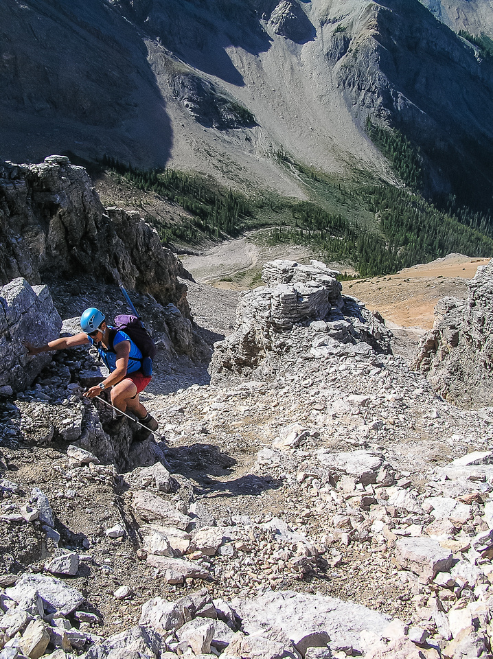 Tackling some low, easy rock bands on the huge ascent slope under the false summit block.