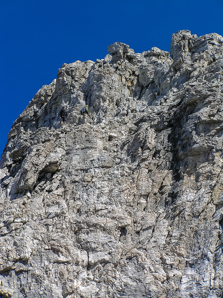 Note the two guys down climbing the 'normal' Kane crux wall that protects the summit block.