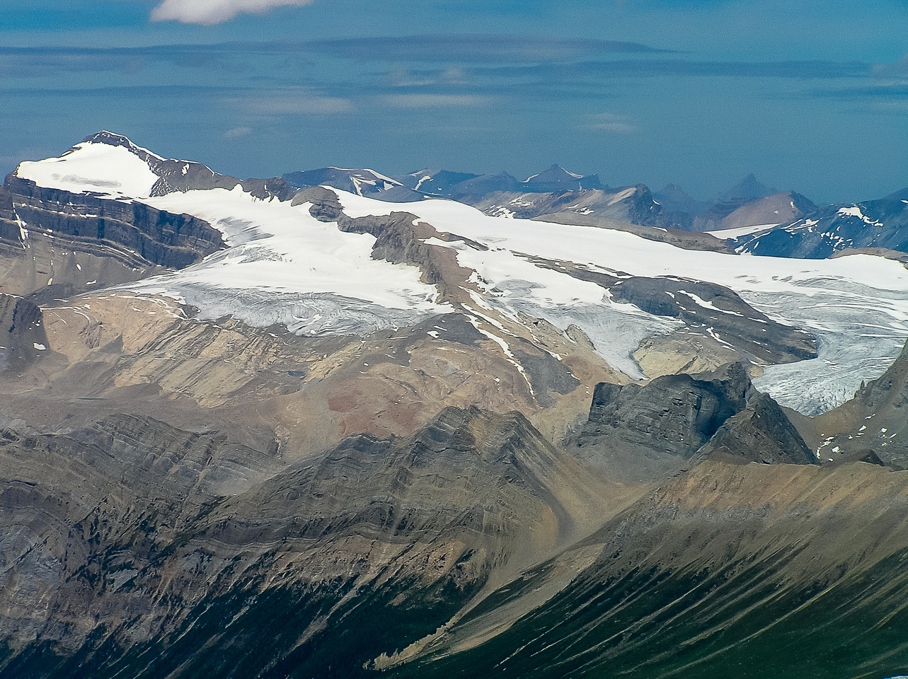 The long ridge of Mount Balfour rises right to left over the Wapta Icefield.