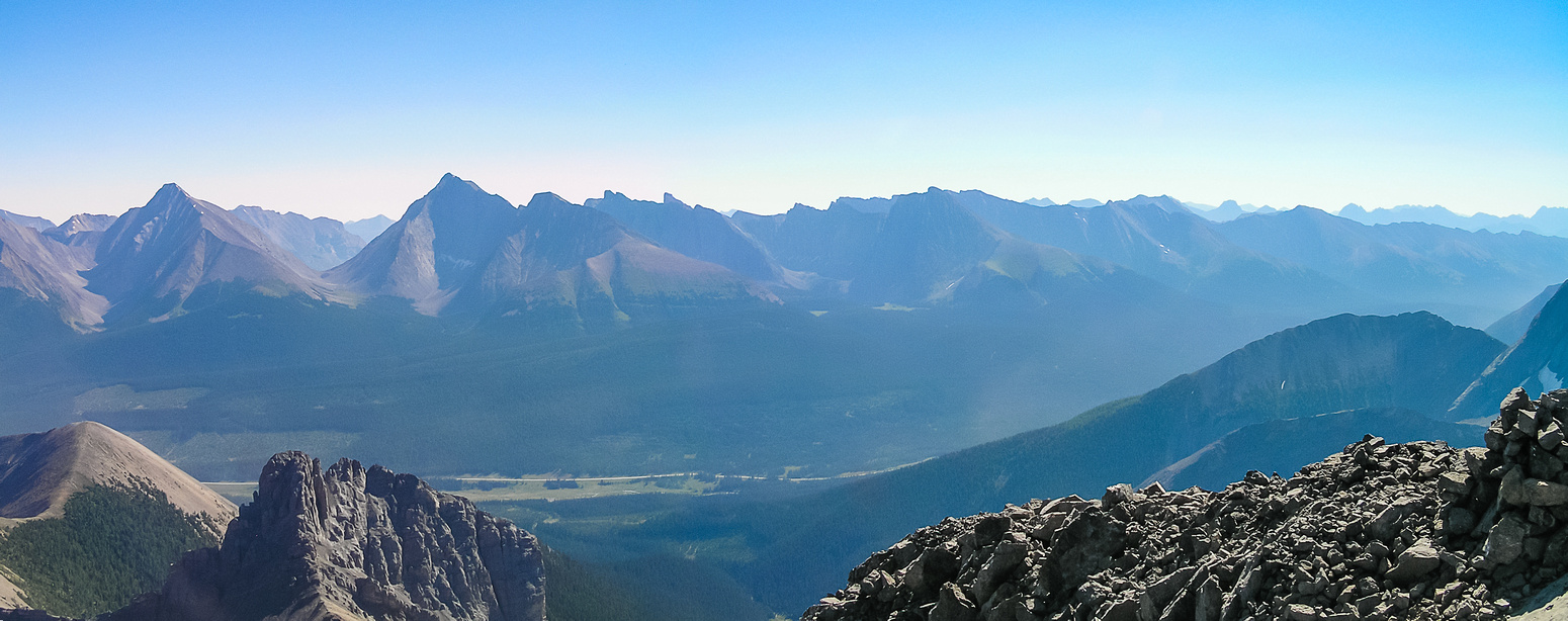 Galatea, Chester, Kent Ridge and other peaks between Spray Lakes Road and Hwy 40 show up in the summer haze.