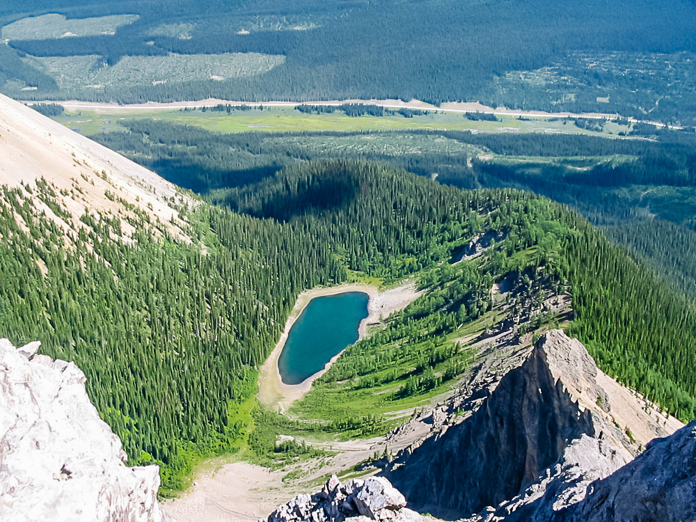 Gorgeous Tryst Lake with the Spray Lakes road in the background from the summit ridge of The Fist.