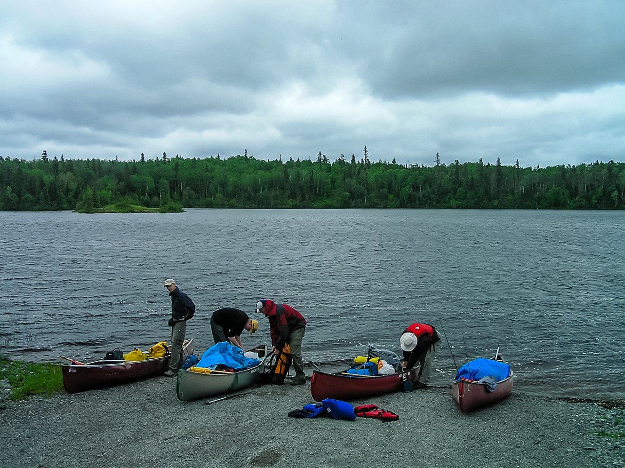 Putting in at the Beresford Lake boat launch. A typical start to a canoe trip - clouds and wind!