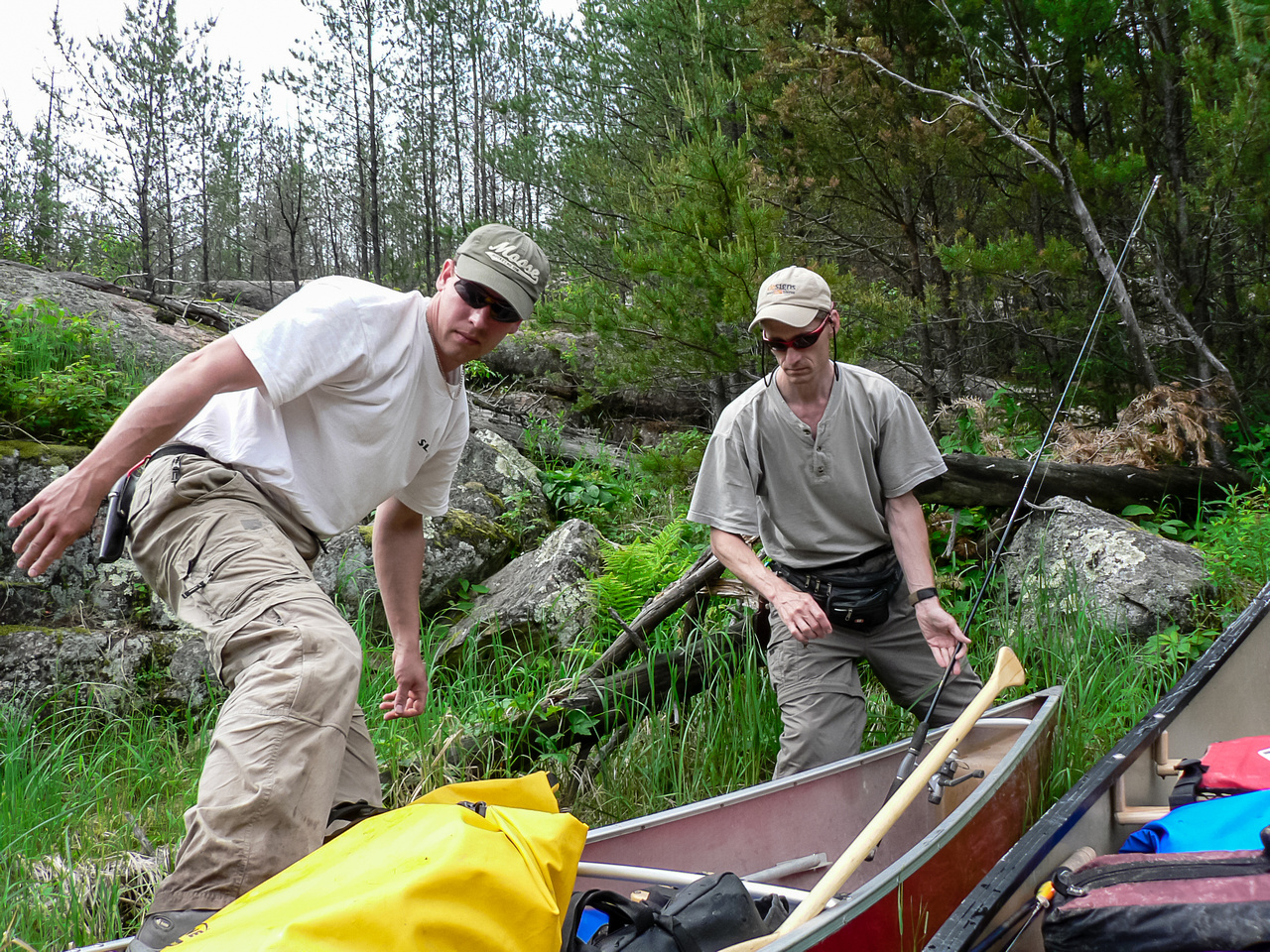 Harold steps into the canoe after another portage.