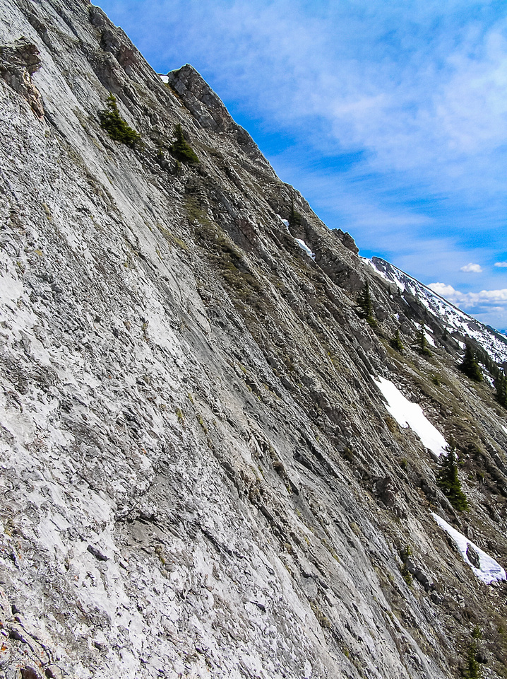 It isn't always an option to traverse under the ridge simply due to slabby terrain like this.