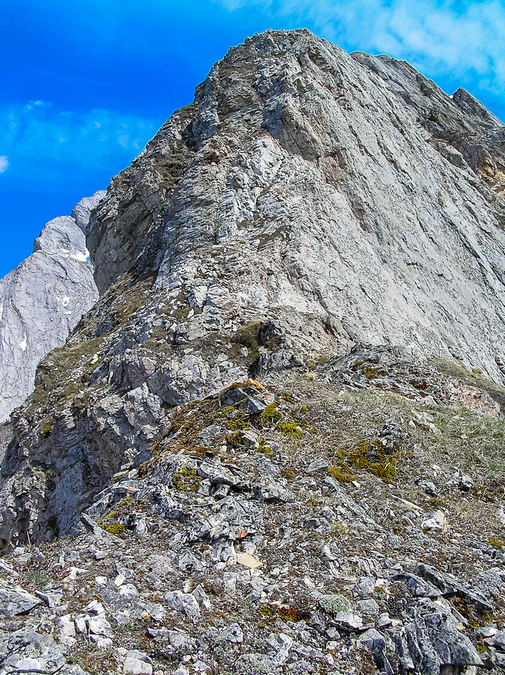 The lower ridge is already challenging. I would suggest looking back a few times so that you know the route and are aware what you will have to down climb if you return via the ridge.